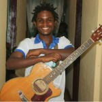 Happy Awu with his guitar
